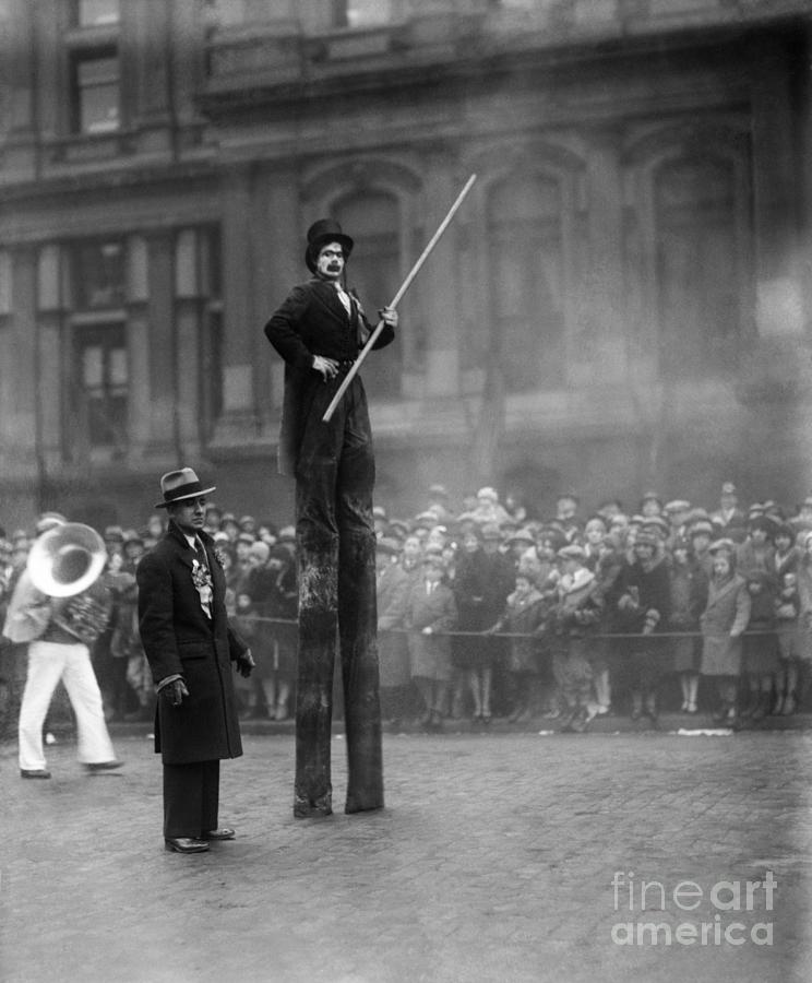 Performer On Stilts Photograph by Bettmann