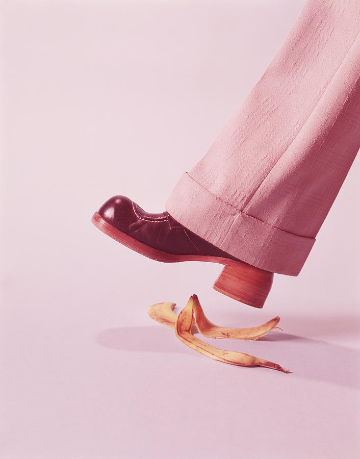 Person About To Step On Banana Skin Photograph by H. Armstrong Roberts