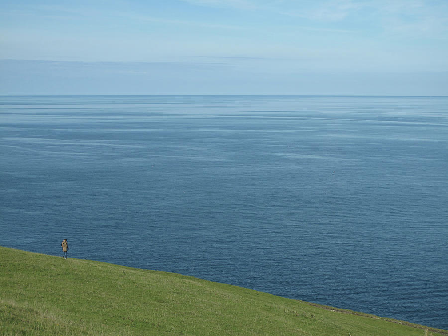 Person Looking Out To Sea In Cornwall Photograph by Thepurpledoor