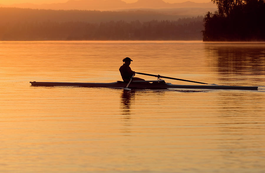 Person Rowing Sculling Boat On River Photograph by Pete Saloutos