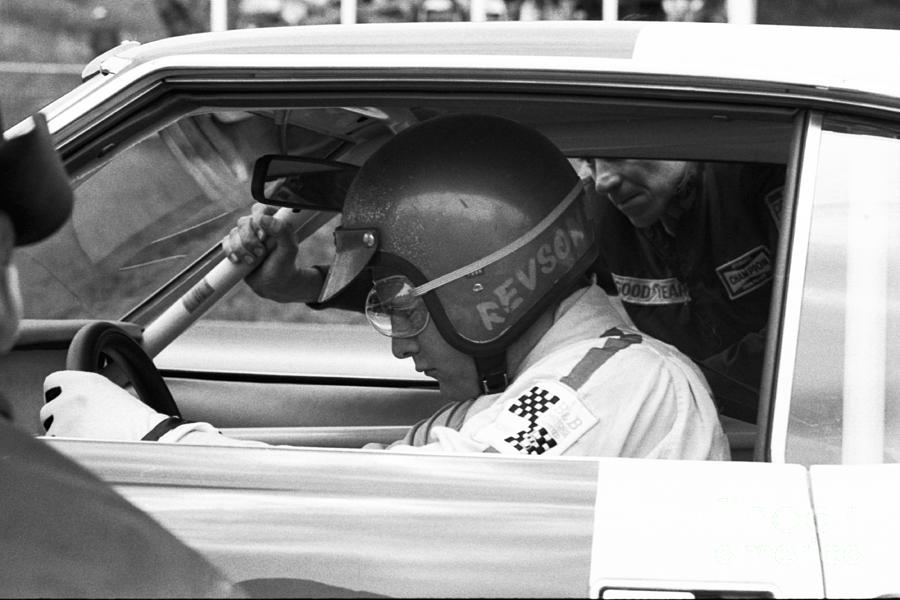 Peter Revson in pits by Dave Allen