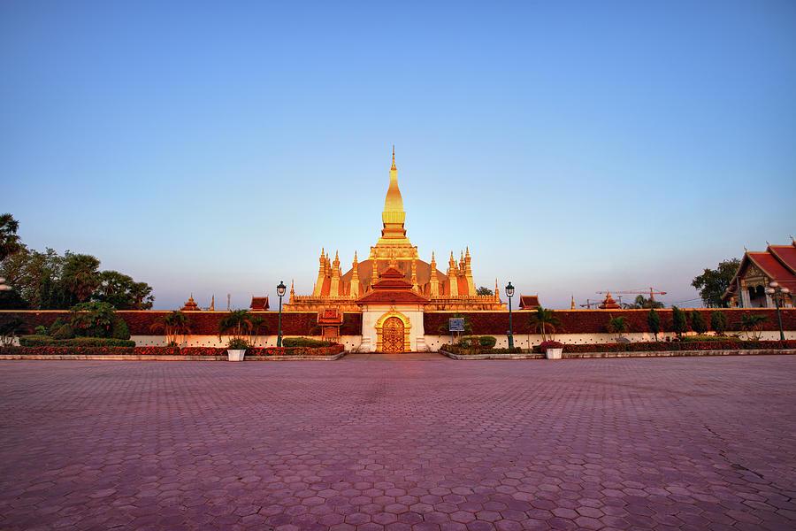 Pha That Luang Stupa At Sunset Photograph by Fototrav