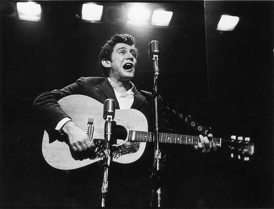 Phil Ochs Performs On Stage Photograph by Fred W. McDarrah