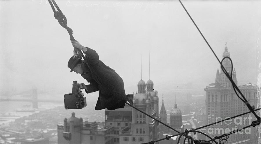 Photographer Balanced On Rope Photograph by Bettmann