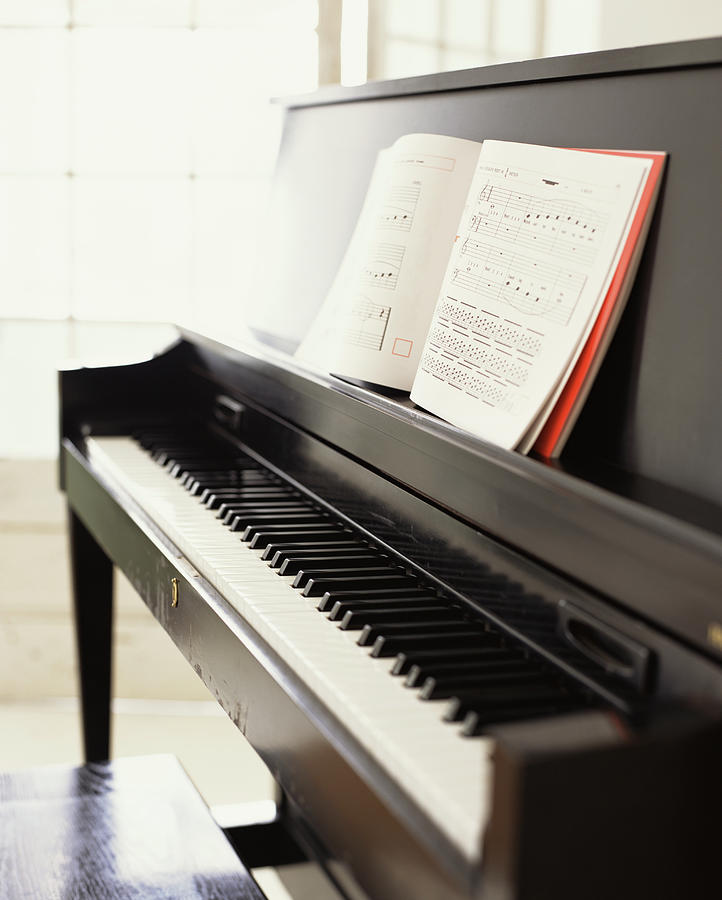 Piano With Sheet Music Photograph by James Baigrie