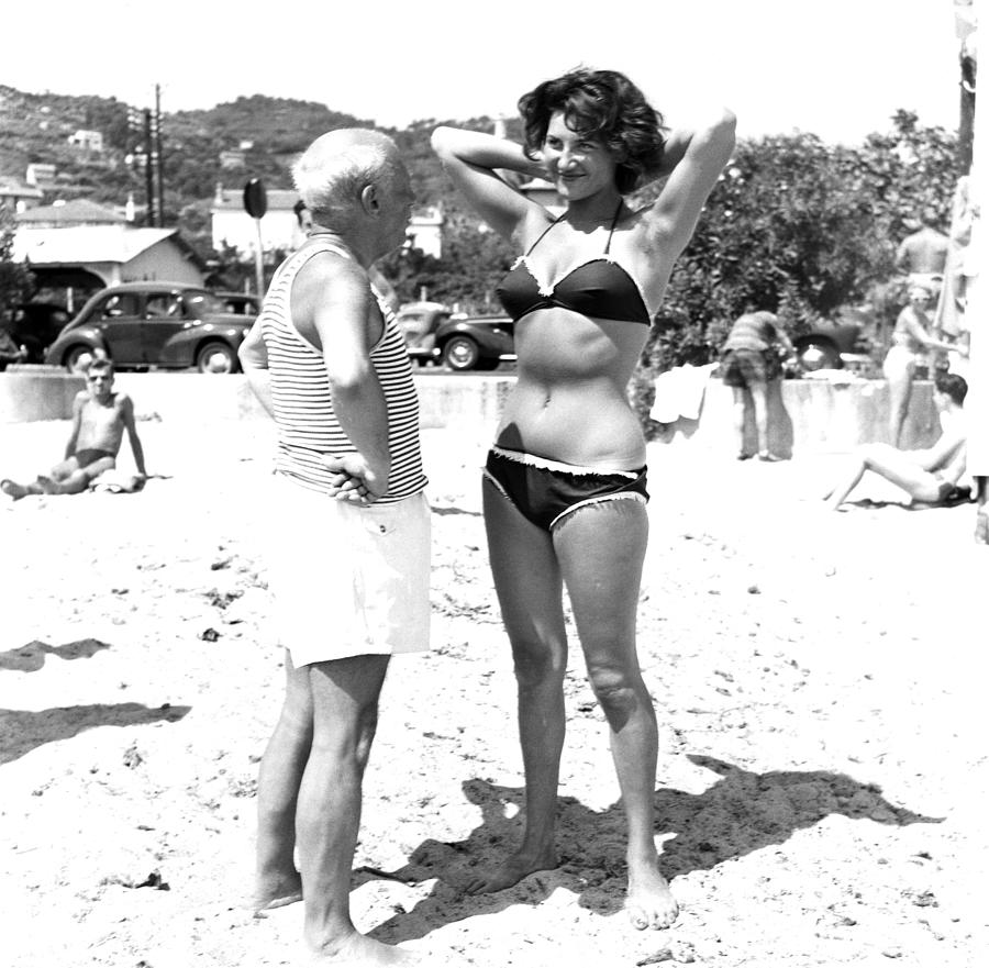 Picasso And Bikini-clad Woman On The Photograph by Hulton Archive