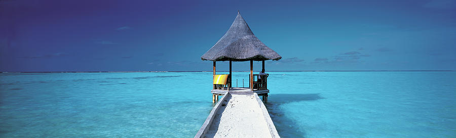 Pier And Blue Indian Ocean, Maldives Photograph by Peter Adams