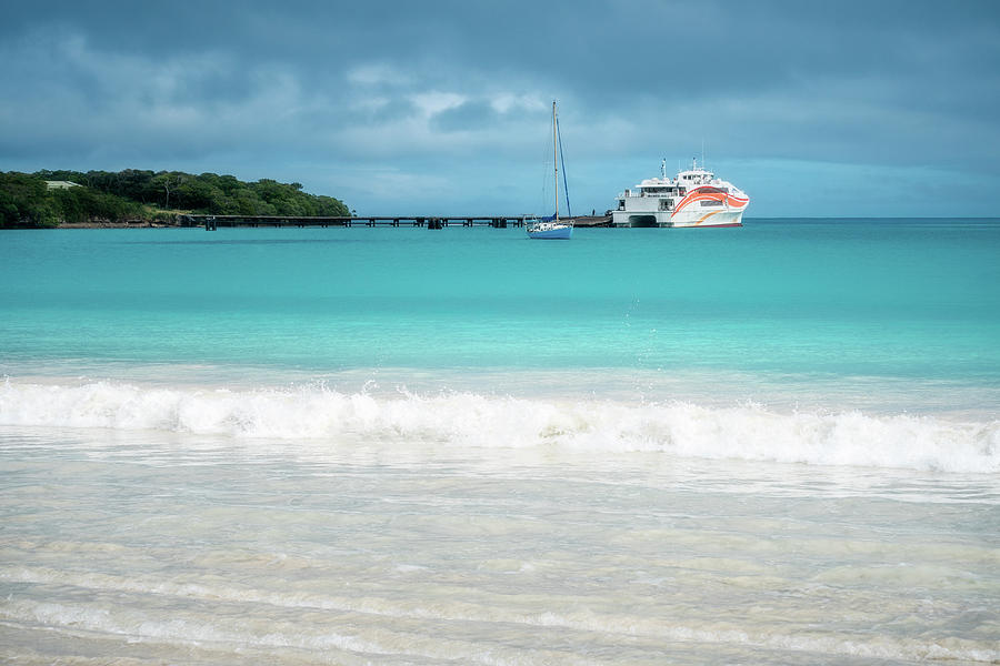 Pier and ferry boat at Kuto Bay in New Caledonia by Daniela Constantinescu