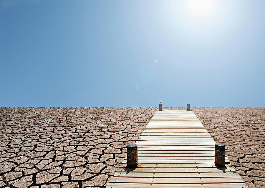 Pier Over A Dry Lake Bed Photograph by John Lund