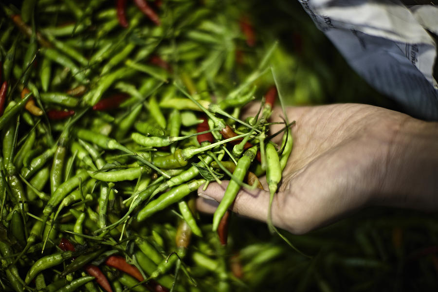Pile Of Fresh Chilis For Sale In Market Photograph by Niels Busch