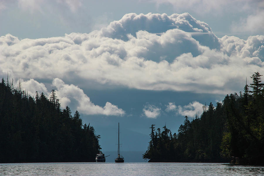 Pillowy Clouds Over a Narrow Pass on the Water by Pacific Northwest Sailing