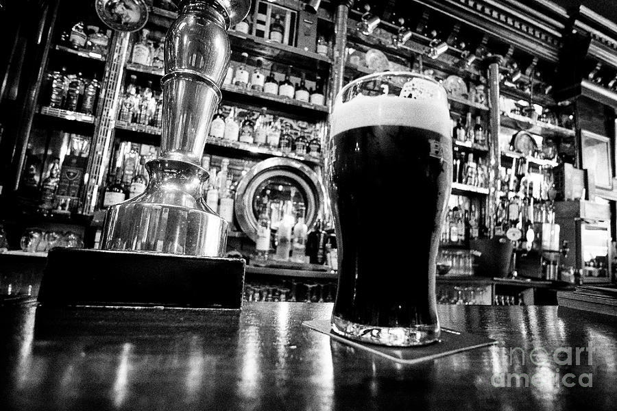 Dublin Photograph - pint of beamish stout in The Long Hall victorian pub one of the oldest pubs in Dublin republic of Ir by Joe Fox