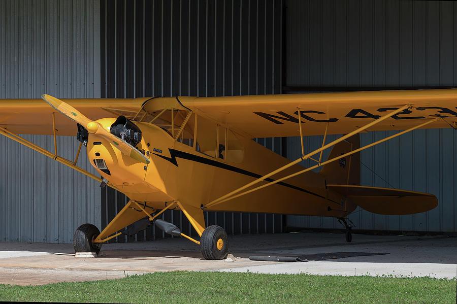 Piper Cub in Hangar by Chris Buff