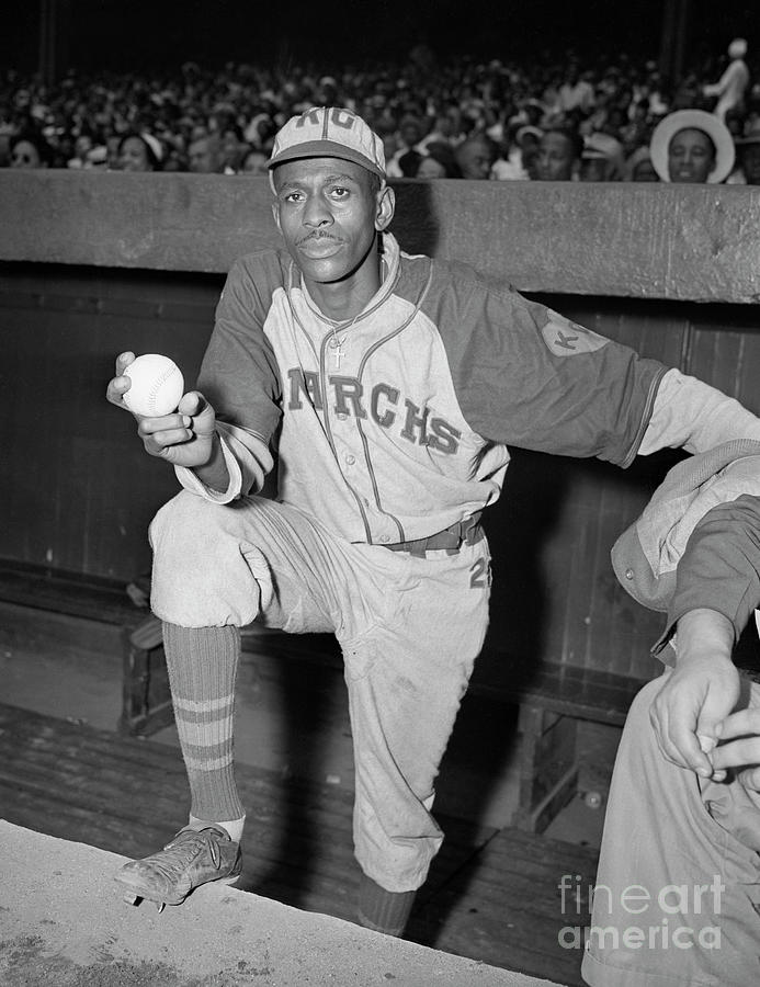 Pitcher Satchel Paige Standing In Dugout Photograph by Bettmann
