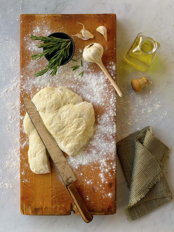 Pizza Dough And Ingredients On Cutting Photograph by Brian Macdonald
