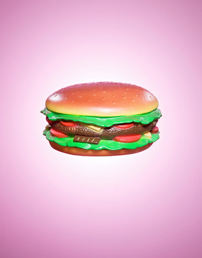 Plastic Burger On Pink Background Photograph by Rowan Fee