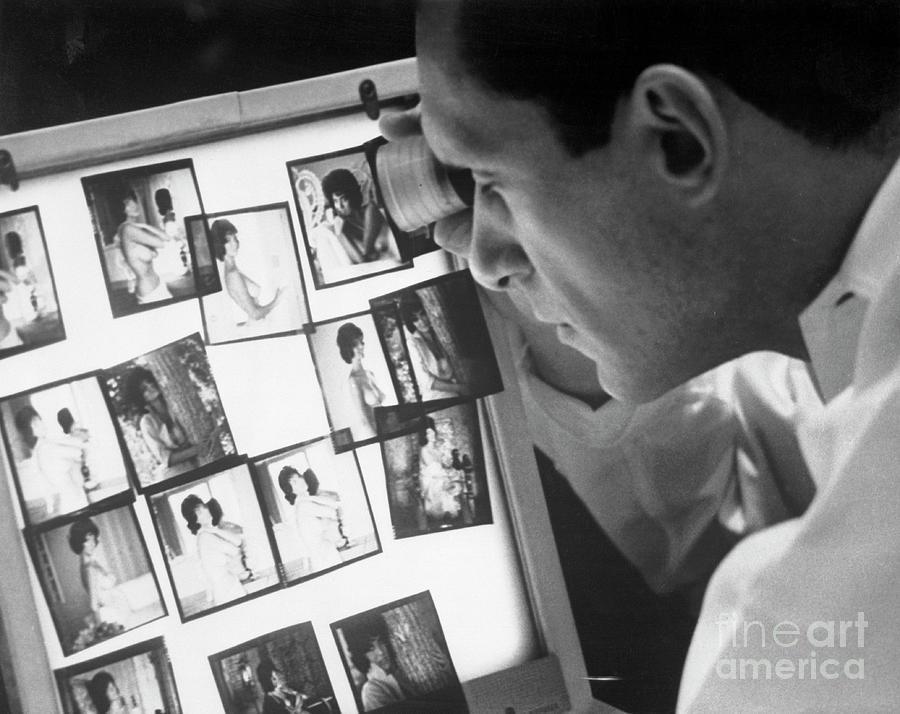 Playboy Publisher Hugh Hefner Observing Photograph by Bettmann