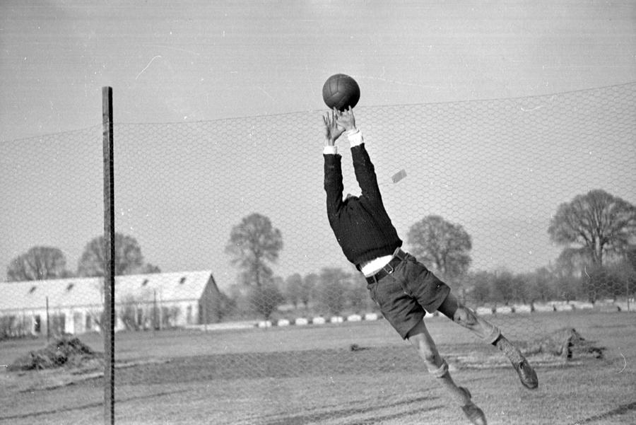 Playing In Goal Photograph by Kurt Hutton