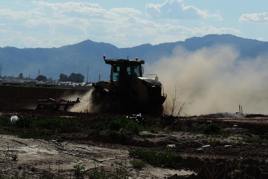 Plowing Dirt by Bill Tomsa