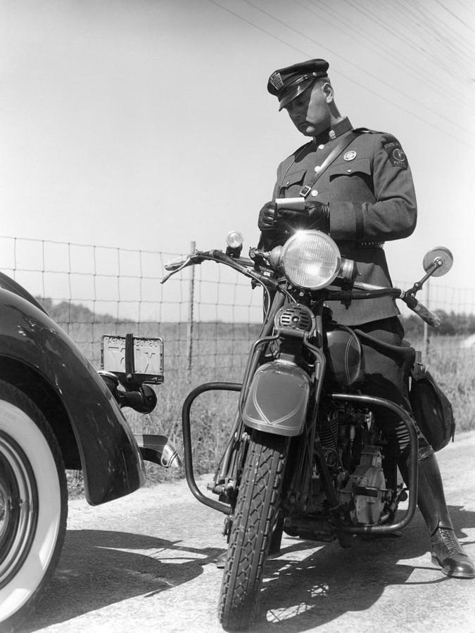 Policeman On A Motorcycle Writing A Photograph by H. Armstrong Roberts