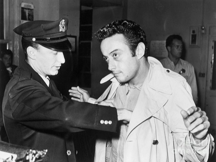 Policeman Searching Comic Lenny Bruce Photograph by Bettmann