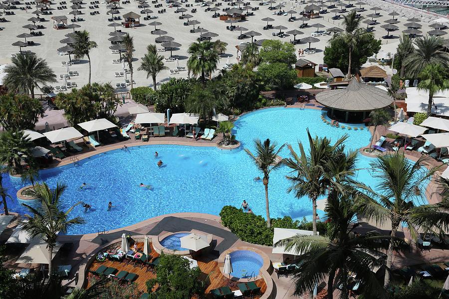 Pool And Beach Parasols, Jumeirah Photograph by Rosemary Calvert
