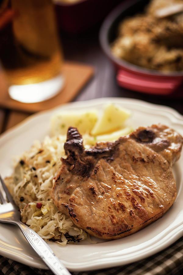Pork Chop And Sauerkraut Photograph by Gmvozd