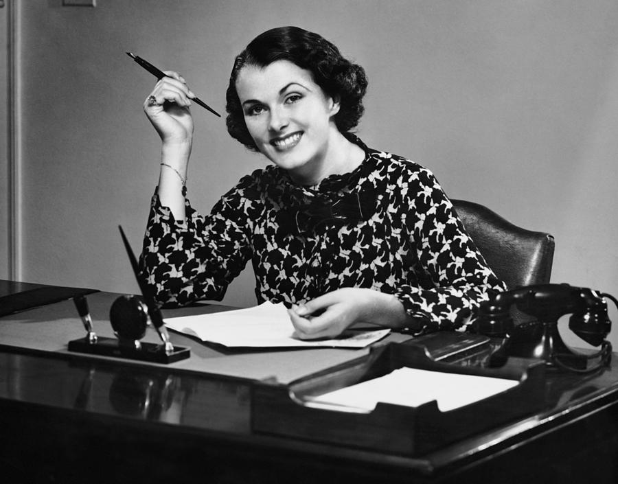 Portrait Of Businesswoman At Desk Photograph by George Marks