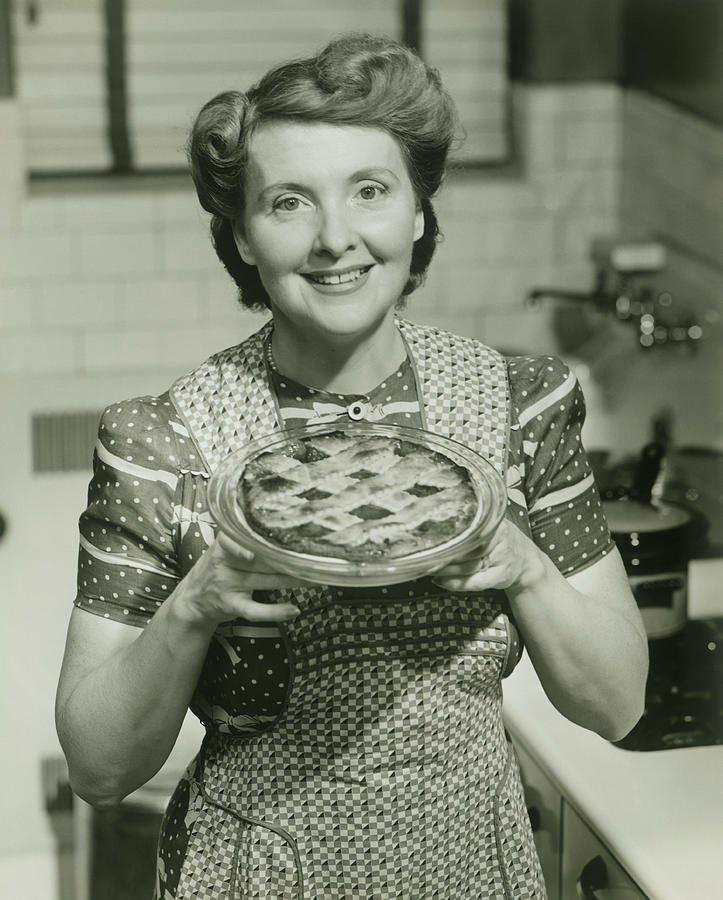 Portrait Of Mature Woman Holding Pie Photograph by George Marks
