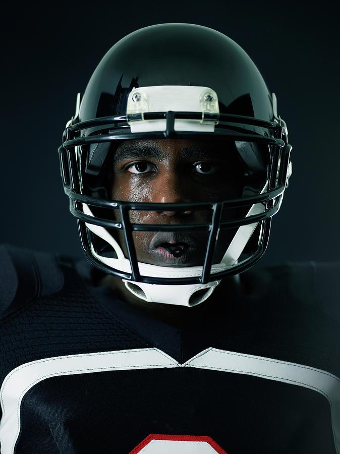 Portrait Of Sweating Football Player Photograph by Thomas Barwick