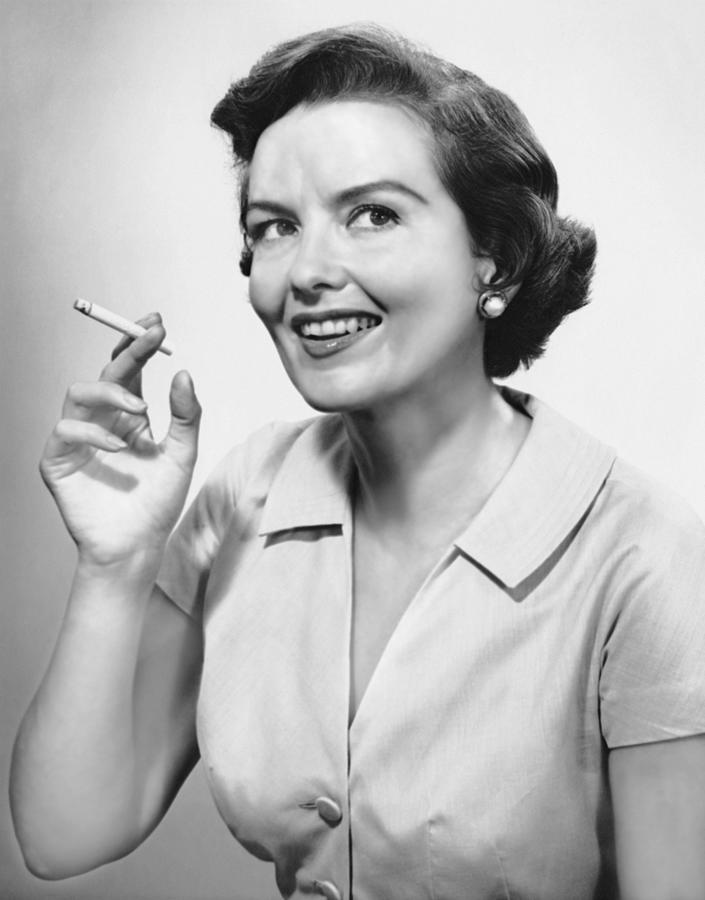 Portrait Of Woman Holding Cigarettte Photograph by George Marks