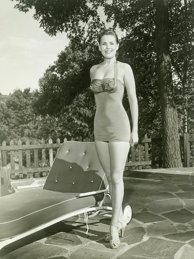 Portrait Of Young Woman By Lounge Chair Photograph by George Marks