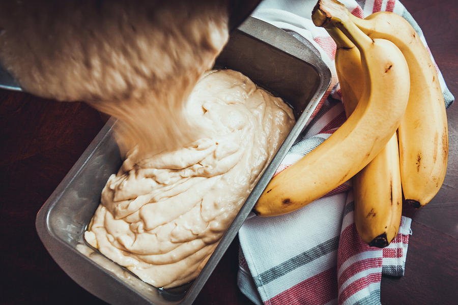 Pouring Banana Bread Batter Into Pan by Jeanette Fellows