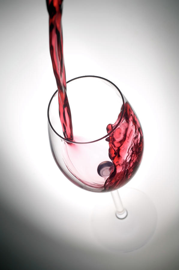 Pouring Red Wine Into A Glass Photograph by Stockcam