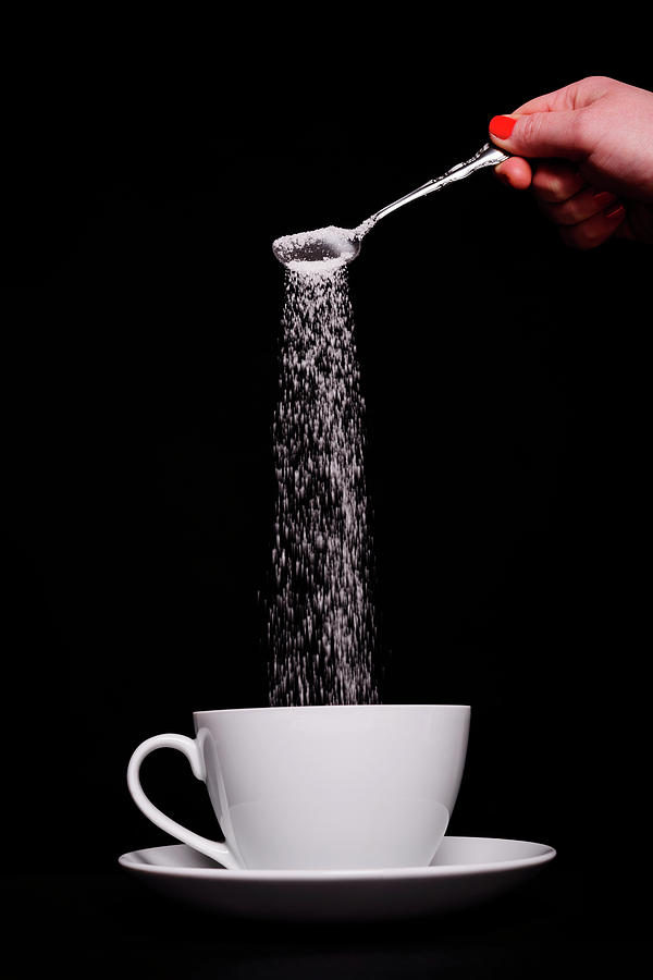 Pouring Sugar Photograph by Stock colors