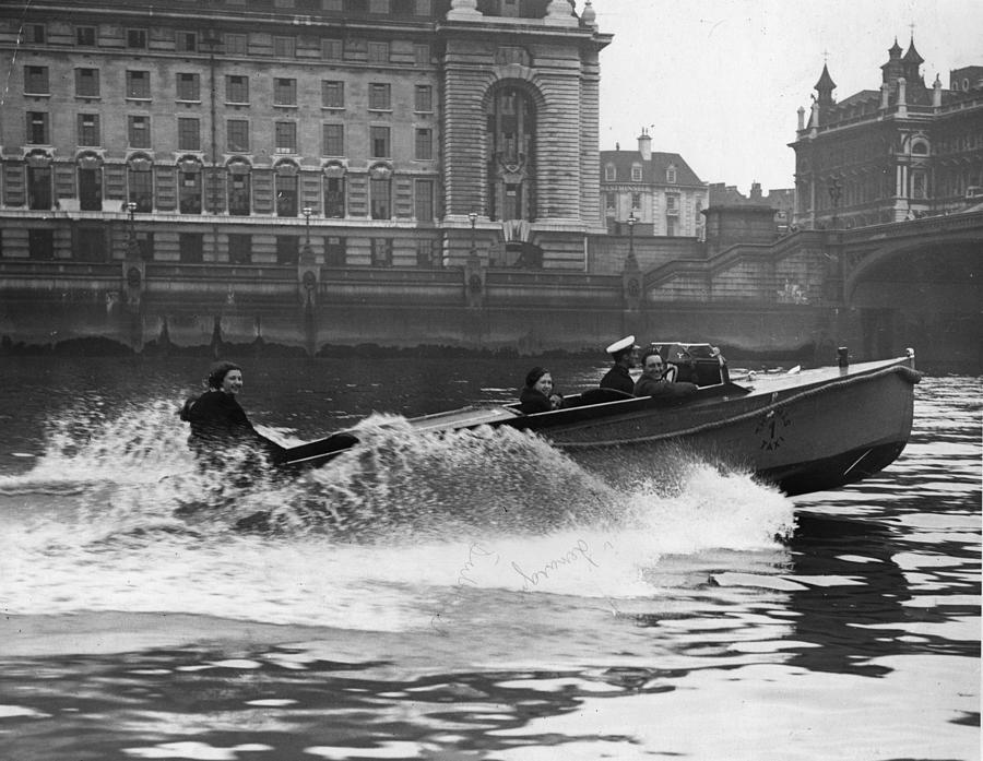 Powerboat Rides Photograph by Fox Photos