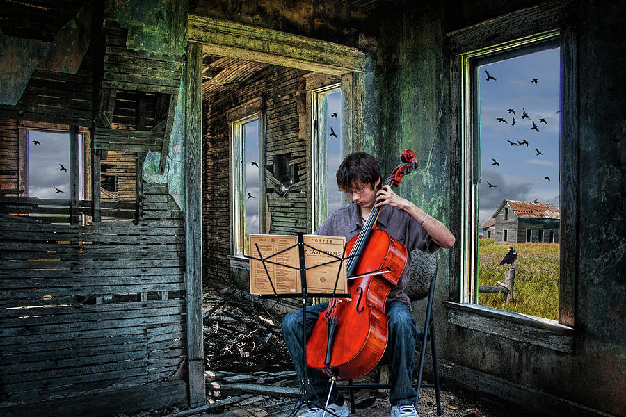 Practicing among the Ruins. A Cello Player playing Music by Randall Nyhof