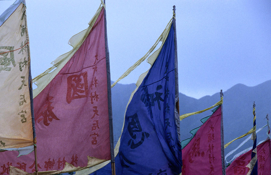 Prayer Flags To The Sea Goddess Blow In Photograph by Lonely Planet