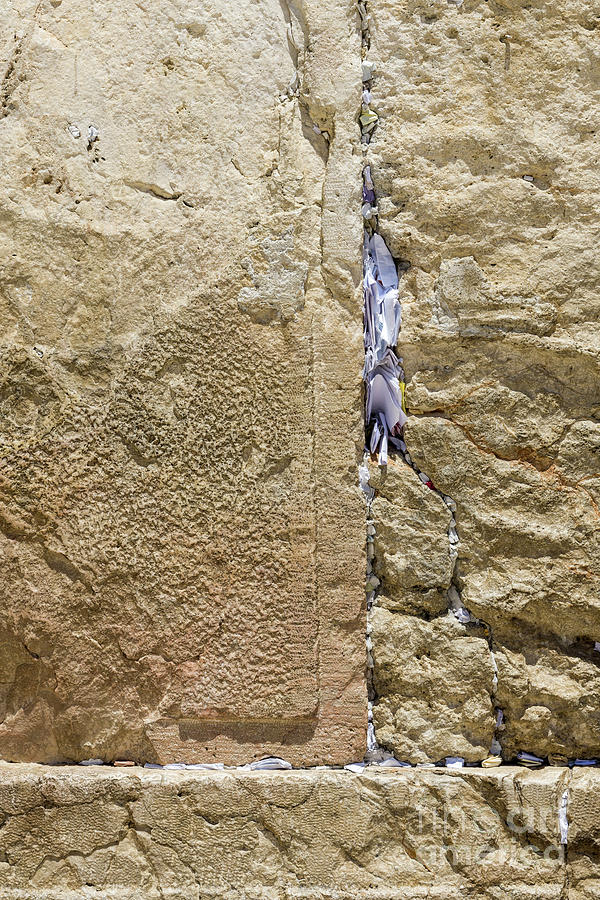 Prayer slips left in the Western Wall in the Jewish Quarter of t by William Kuta