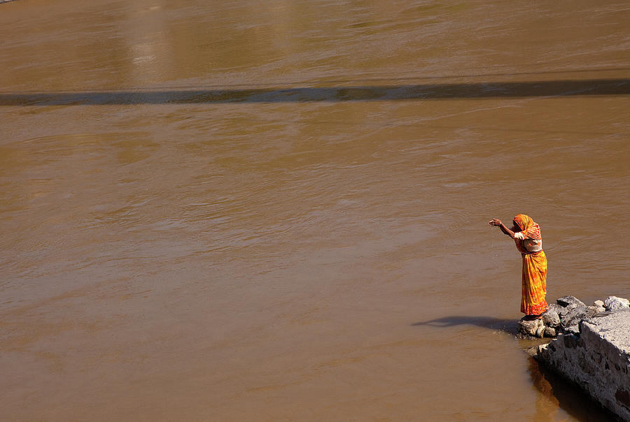 Praying On  Banks Of Holy Ganges In Photograph by Claude Renault