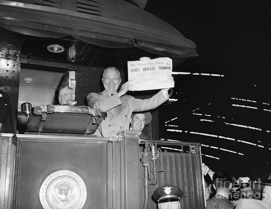 President Harry Truman Holding Photograph by Bettmann