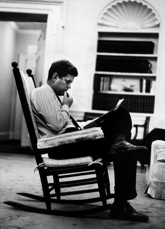 President John F. Kennedy Sitting Photograph by Paul Schutzer