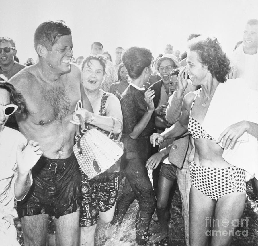 President Kennedy At Beach With Admirers Photograph by Bettmann