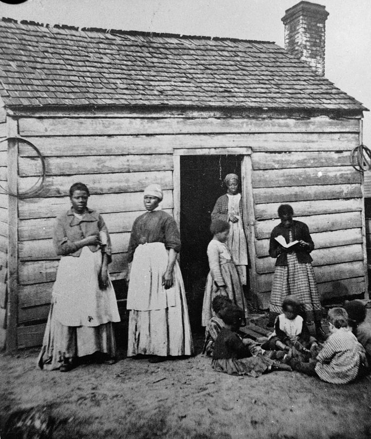 Child Photograph - Presumed Slaves And Their Shack by Hulton Archive