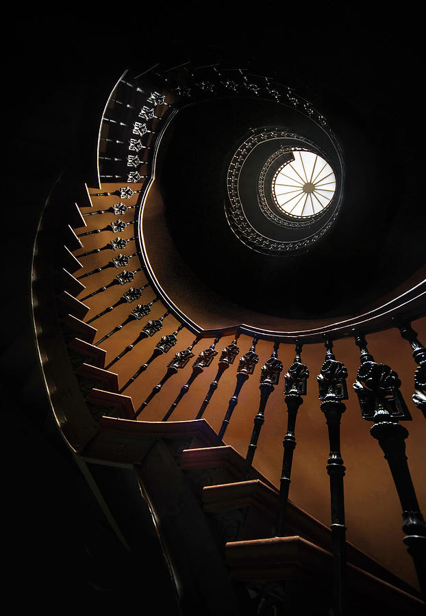 Pretty brown spiral staircase by Jaroslaw Blaminsky