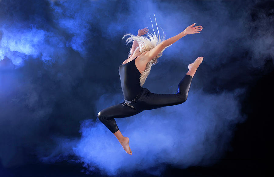 Professional Ballerina Jumping Through Photograph by Skynesher
