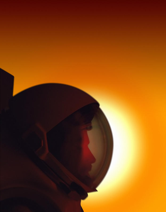Profile Of A Helmeted Astronaut Against Photograph by Photodisc