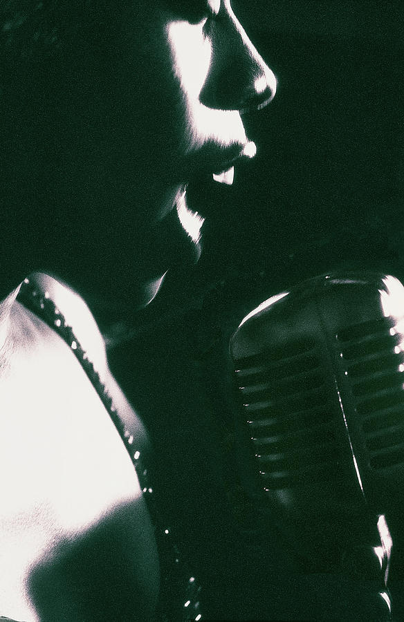 Profile Of Woman Singing Into Microphone Photograph by Digital Vision.