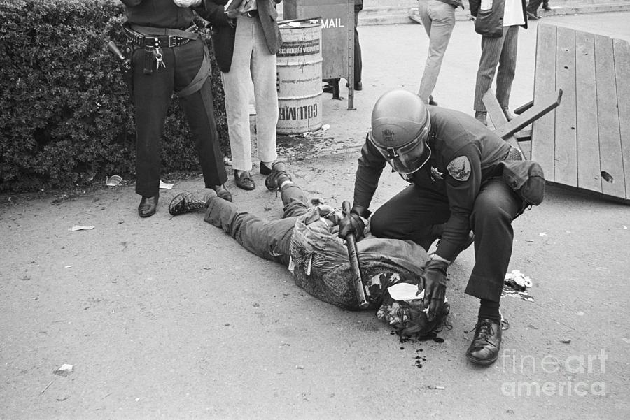Protester Lying Injured On Sidewald Photograph by Bettmann