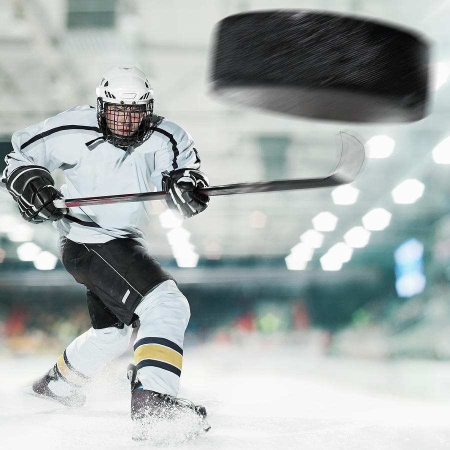 Puck Shot By Ice Hockey Player Photograph by Bernhard Lang